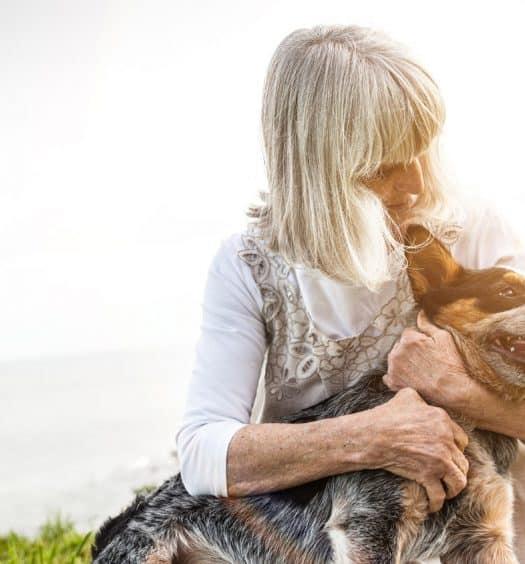 Senior woman adopting a dog