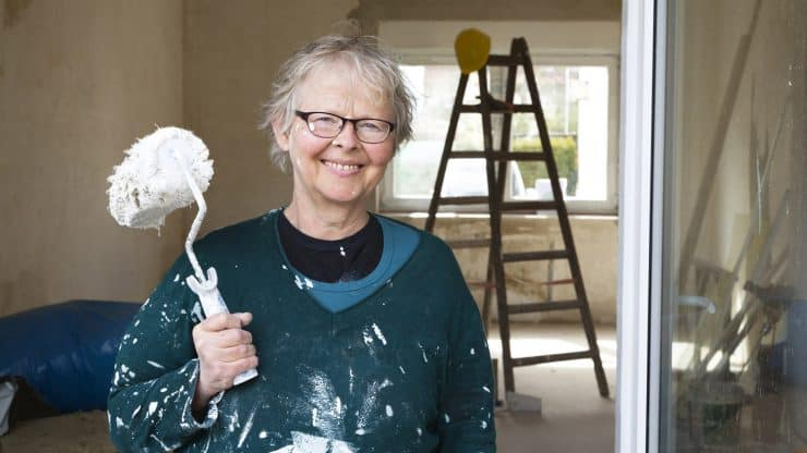 senior woman home maintenance