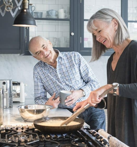Senior woman cooking recipes