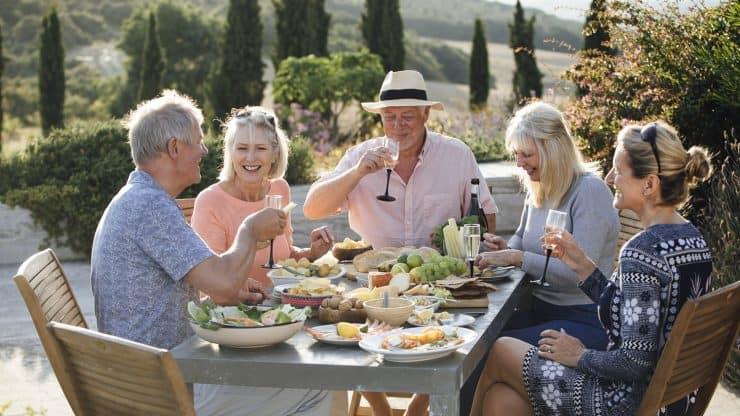 Senior Friends Over a Bottle of Wine in Barossa Valley, Australia