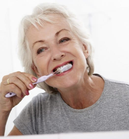 Senior woman teeth care