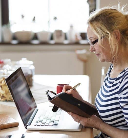 Senior woman keeping a diary