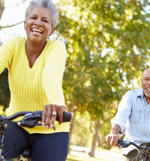 two seniors riding bikes and getting fit after 60