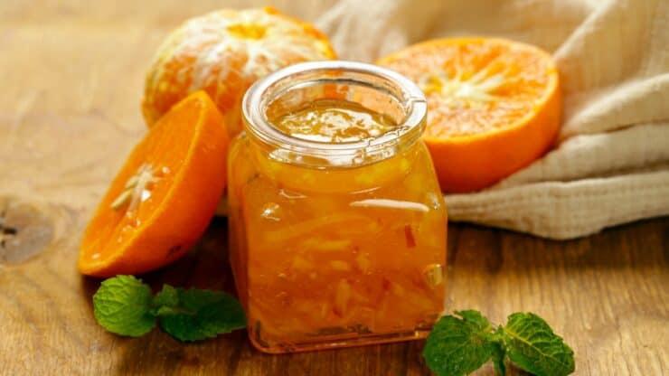 preparing homemade jar of marmalade